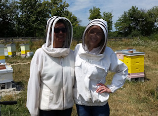 Two honeybee experience tourist smiling